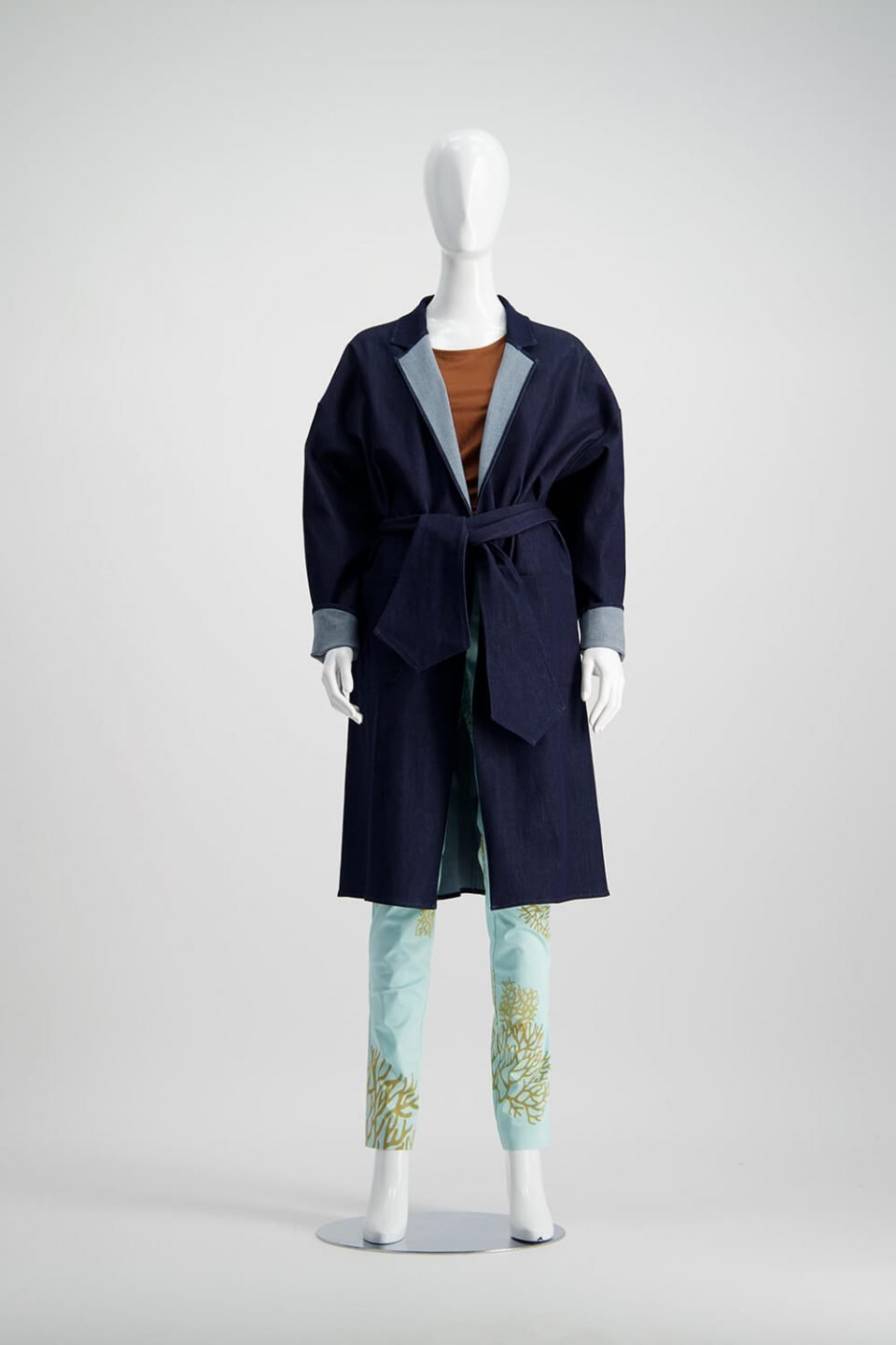 Denim coat over a brown top and green pants from WORLD brand