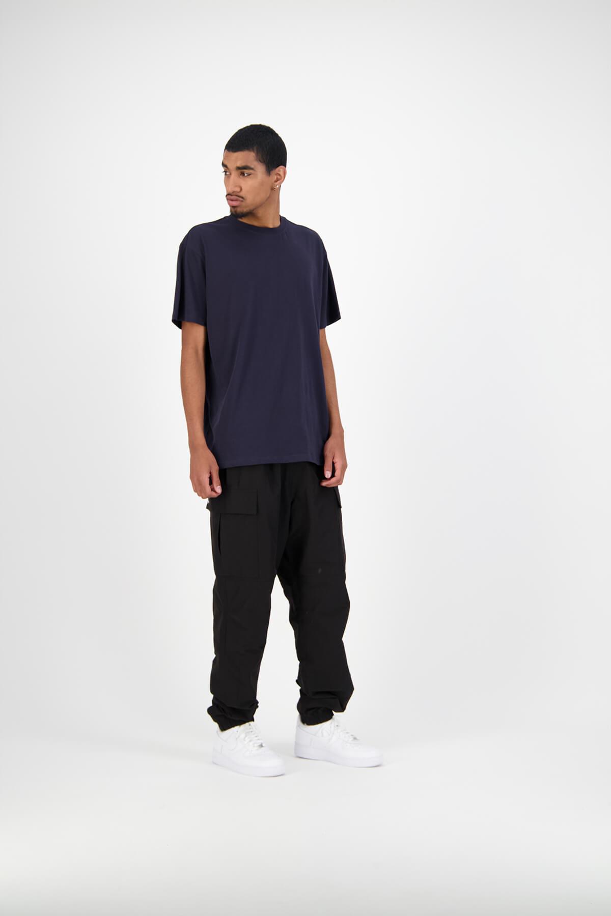 Huffer male model in studio wearing blue navy tee