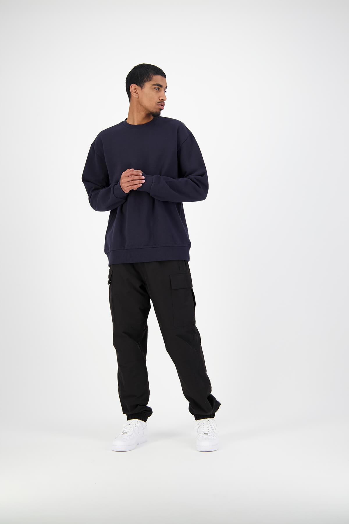 Huffer male model in studio wearing navy crewneck