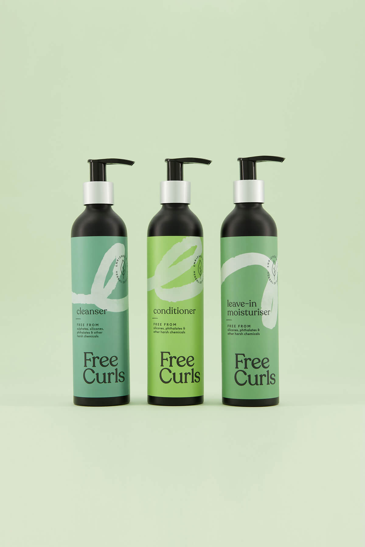 Free Curls haircare bottles product group photography in studio